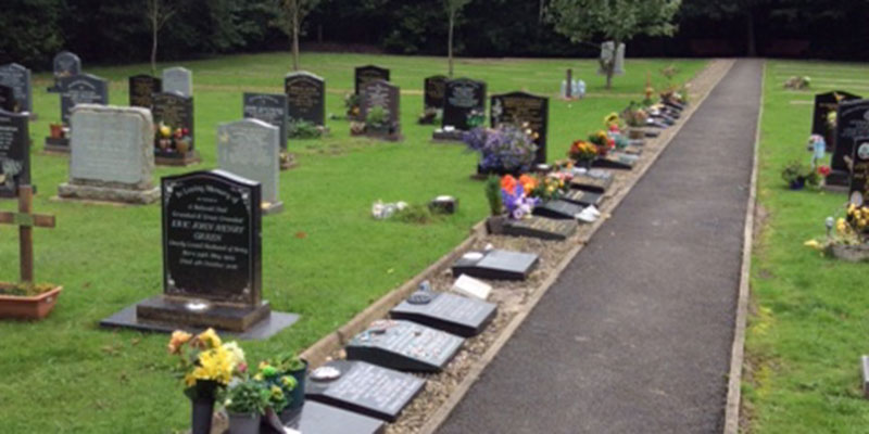 photograph of cemetery pathside plots